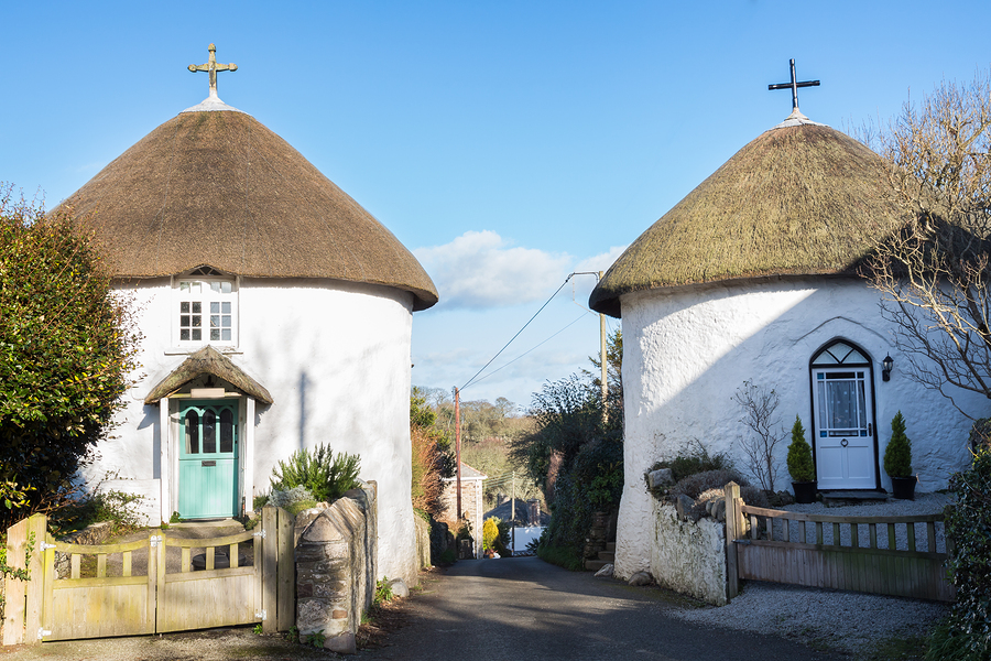 Historic thatched round houses at Veryan on the Roseland Peninsula Cornwall England UK Europe